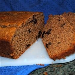 Grandma's Apple Bread Recipe - Sweet, spicy quick bread with applesauce and raisins. Good for snacks.