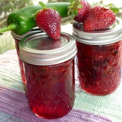 Jalapeno Strawberry Jam Recipe - This is a favorite in our family at Christmas. The flavor of the sweet strawberries combined with the flavor of the peppers gives this jam a wonderful flavor dimension. This jam is not spicy, but can be made to be spicy by adding more peppers or a few habanero peppers.