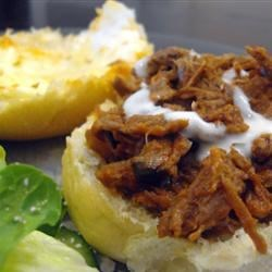 Barbecue Beef for Sandwiches Recipe - Pot-roasted beef is shredded and simmered with hot, spicy sauce. This recipe will feed a crowd (16 to 20 sandwich servings). Leftovers may be frozen for later use.