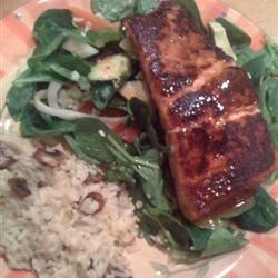 BBQ Salmon over Mixed Greens Recipe - Barbecued salmon fillets served with a homemade vinaigrette dressing on a bed of mixed greens. This recipe is full of flavor and color and will impress your friends.