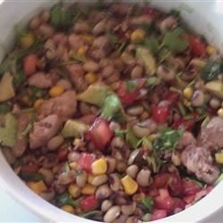 Black-Eyed Pea Dip Recipe - This mixture of canned black-eyed peas, tomatoes and cilantro looks a lot like salsa.