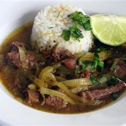 Bistec Encebollao Recipe - Use any cut of steak when making this easy beef stew. Marinated in oil, oregano, vinegar, and onions, this is a great meal for a busy weeknight. A staple in Puerto Rican cooking. Serve with white rice and tostones. Water can be used in place of beef stock if desired.