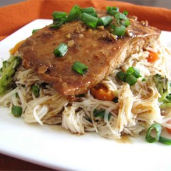 Soy Ginger Salmon Recipe - Salmon is marinated overnight in soy sauce, brown sugar, orange juice, spices, and fresh ginger; then broiled to perfection! My family and friends rave about this fish.