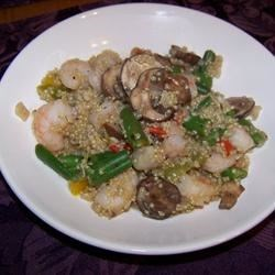 Shrimp Quinoa Recipe - Hot cooked quinoa is tossed with shrimp, asparagus, red bell pepper, and mushrooms in this one dish meal.
