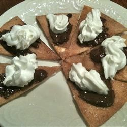 Easy Chocolate Nachos Recipe - Cinnamon-sugar baked tortilla chips are drizzled with warm chocolate sauce in this snack that's sure to satisfy your chocolate cravings!