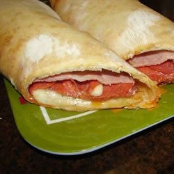 Stromboli Recipe and Video - The stromboli that I make uses pre-made pizza dough.  But bread dough can be used as well.  Kids love this pizza creation and adults love the grown-up pizza creation.  Also, I always have left-over mixture, which I use the following day with Spaghetti.