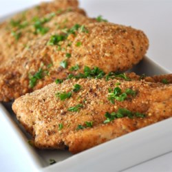 Baked Garlic Parmesan Chicken Recipe and Video - Chicken breasts are breaded with flavorful crumbs, herbs, and Parmesan cheese, then baked for the easiest, quickest chicken dish ever. Serve with a salad and pasta or rice for a scrumptious dinner.