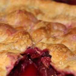 Always Delicious Cherry Pie Recipe - A large pie made with both sweet and sour cherries. Incredibly yummy with vanilla ice cream!