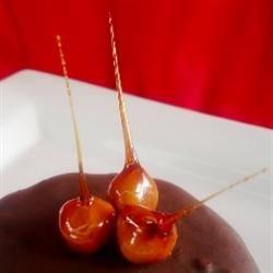 Caramel-Dipped Hazelnuts on top of Nutella Cake with Chocolate Hazelnut Ganache