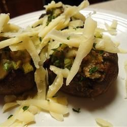 Cheese Stuffed Mushroom Appetizer Recipe - These restaurant quality stuffed mushroom caps are filled with a blend of cream cheese, goat cheese, and onions and drizzled with garlic butter before broiling.