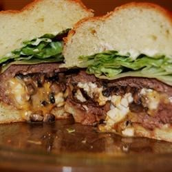 Texas Stuffed Grilled Burgers Recipe - A great change to the usual grilled burgers.  These burgers are stuffed with ham, cheese, mushrooms, and onions then slow grilled. Grill over hickory or mesquite wood if possible for better flavor! A sure family pleaser!