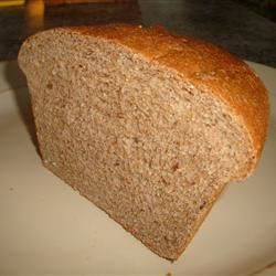 100 Percent Whole Wheat Bread Recipe - Make 2 loaves of 100-percent whole wheat bread with this recipe that includes coconut oil, honey, and lots of different seeds for texture and flavor.