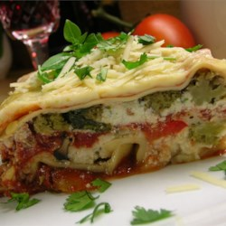 Hearty Vegetable Lasagna Recipe - A pound of fresh mushrooms along with lots of bell peppers and onions gives full-bodied flavor to this vegetable lasagna.