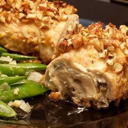 Cream Cheese Chicken Recipe - Chicken breasts are pounded thin, and stuffed with a mushroom and cream cheese mixture. The rolls are then coated with brown sugar and Dijon, and rolled in chopped nuts before baking.