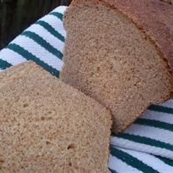 Honey Wheat Bread IV Recipe - If your slow cooker is equipped with a special cake dish, you can bake this honeyed whole-wheat bread in the crock pot!  The result is a tender, moist loaf your entire family will enjoy.