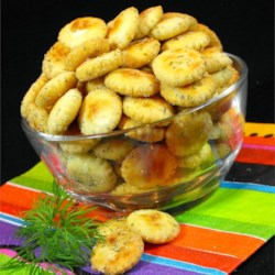 Snack Crackers Recipe - These oyster crackers are 'marinated' in herbs, oil and ranch-dressing mix, then stored in a jar for instant munching.