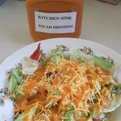 Kitchen Sink Salad Dressing Recipe - We love the name, the taste and that everything goes into the blender. Lots of ingredients, like tomato soup, Worcestershire sauce, and brown sugar. Some make it hot, others make it sweet. The end result is a dressing that you 'll love to keep on hand and toss with your favorite salad.