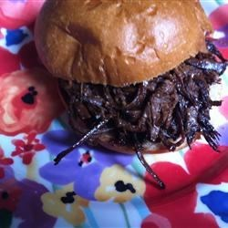 Slow Cooked Barbecue Beer Beef Recipe - Beef brisket is cooked super-slow in a slow cooker until it's falling-apart tender. The shredded beef is served on soft potato buns. This is a great dish for parties as it doesn't require very much last-minute work.