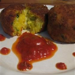 Spinach Arancini Recipe - I used to live in Sicily, and these stuffed rice balls were a favorite of mine! 'Arancini' means 'Little Oranges' in Italian, named so because the little breaded rice balls resemble small oranges so much.