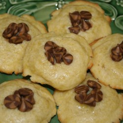 Naughty Chocolate and Peanut Butter Chip Cookies Recipe - This naughty little cookie is richly flavored with port wine. The cookies are redeemed when chocolate and peanut butter chips are melted into the center.