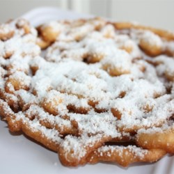 Funnel Cakes III Recipe - Easy fried treats made with a batter similar to pancake batter.