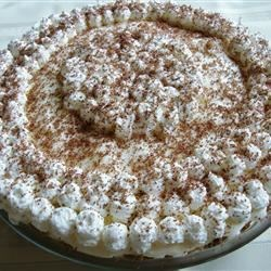 Black Bottom Pie IV Recipe - This irresistible pie has a doubly nice bottom. The pastry is made from spicy gingersnaps and the first layer of the pie is a yummy chocolate concoction covered with a light and airy rum filling. It's then topped with whipped cream.
