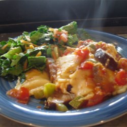 Ratatouille Bake Recipe - Garden veggies, including eggplant and zucchini, are layered onto ready-made cheese ravioli, topped with mozzarella cheese, and baked.