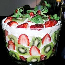 Joy's Prizewinning Trifle Recipe - Cake and a pudding, sour cream, whipped topping fluff layered with pineapple, banana, kiwi, and strawberries.