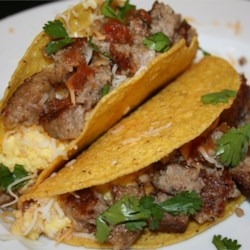 Sausage and Egg Tostadas Recipe - Make your next brunch a special occasion with tostadas filled with crumbled sausage, shredded cheese, cooked eggs and salsa.