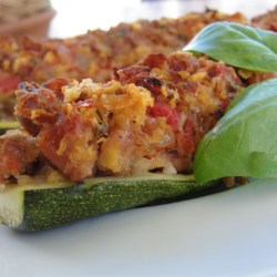 Stuffed Zucchini with Chicken Sausage Recipe - Zucchini get a light and tasty stuffing of Italian chicken sausage, sweet onion, tomato, and Parmesan cheese before being baked.