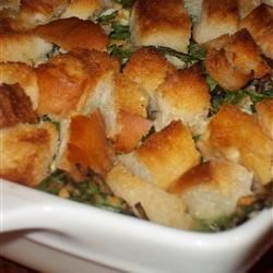 Not Your Mama's Tuna Casserole Recipe - This hearty tuna casserole is dramatically different and decadently delicious.  A creamy blend of tuna, spinach, and hard boiled eggs is topped with buttered bread and baked until crispy on top and hot and bubbly inside.