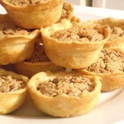 Tiny Tarts Recipe - Yummy miniature pecan tarts. Wonderful on holiday cookie trays.