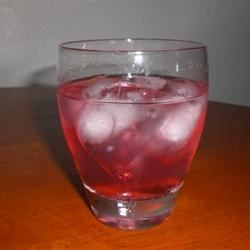Teeny Weeny Woo-Woo Recipe - Vodka and peach schnapps are topped off with a splash of cranberry juice. The title would be a hit at a Passion Party!