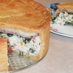 Torta Rustica Recipe - Hearty, robust and savory, this torta starts with a terrific cornmeal pastry that is fitted into a springform pan. Layers of cheese, chopped spinach, prosciutto, and roasted red peppers fill the pie. A top crust is fitted on, and then the torta is baked until it's golden.