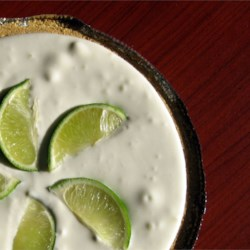 Limeade Pie Recipe -  For this quick-to-make pie, limeade concentrate, sweetened condensed milk, and whipped topping are combined in one bowl. And once this luscious filling is poured into it 's graham cracker crust, the fridge does the rest.