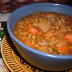 Lentil Soup III Recipe - Just lentils, chicken broth, onion, tomato paste, garlic and cumin in this quick soup.