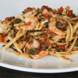 Fresh Tomato Shrimp Pasta Recipe - Fresh tomatoes and spinach, fresh herbs, and fresh mozzarella combine with shrimp and fettuccine for an easy summer dinner.