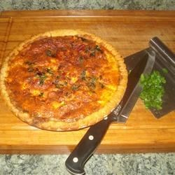 Sausage and Sun-Dried Tomato Quiche Recipe - Rich and flavorful - this pie is made with sun-dried tomatoes, breakfast sausage, fresh herbs, heavy cream, and shallots in a premade pie crust. It is a perfect Sunday morning breakfast quiche.