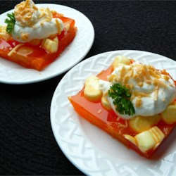 Apricot-Orange Gelatin Salad Recipe - A sprinkling of grated Longhorn cheese balances the sweetness in this gelatin based fruit and nut salad.
