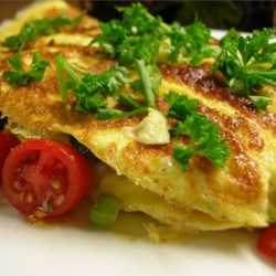 Yummy Veggie Omelet Recipe - Great directions to make the most perfect, fluffy and foldable omelet. Stuffed with gently sauteed vegetables and lots of cheese. Yummy indeed.