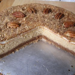 Pecan Cheesecake Recipe - This recipe makes a cheesecake between a graham cracker crust and a pecan topping for a nice Thanksgiving Day cheesecake.