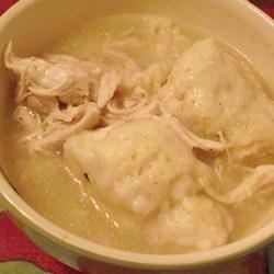 Chicken and Dumplings IV Recipe - Chicken is boiled and shredded, then simmered with baking mix dumplings in this simple, thick soup.