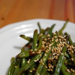 Tasty Green Beans Recipe - Tired of plain old steamed green beans?  These are rich and savory because they are cooked with beef bouillon and soy sauce.