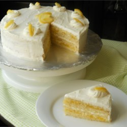 Lemon Cake with Lemon Filling and Lemon Butter Frosting Recipe - A four layer cake, filled with lemon curd and covered with lemon frosting.