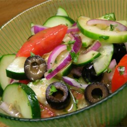 Cucumber Tomato Salad with Zucchini and Black Olives in Lemon Balsamic Vinaigrette Recipe - Enjoy this veggie salad while the cucumbers, tomatoes, and zucchini are ripe on the vines. A lemon-scented vinaigrette dressing, fresh basil, thyme and black olives add their flavor and color.