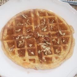 Sweet Potato Pecan Waffles Recipe - A little nutmeg in the batter heightens the sweet potato flavor, and finely chopped pecans give an interesting crunch.  These wonderful waffles will warm you up on a cold morning.