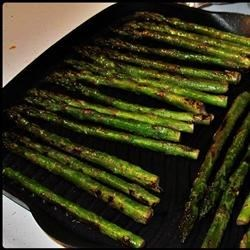 Drunken Grilled Asparagus Recipe - Fresh asparagus is marinated in a Burgundy wine mixture for several hours, then cooked on the grill. This is a great way to enjoy the springtime harvest! Arrange the asparagus around your entree, and grill them at the same time.