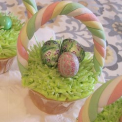 Mini Egg Cupcakes Recipe - Cute cupcakes have a surprise center of a solid chocolate Easter egg baked inside. The cupcakes are frosted and topped with pastel candy-coated chocolate mini eggs for a sweet springtime decorating idea. Make them with the extra candies you have after the holiday.