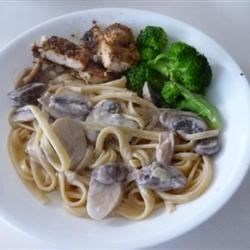 Fettuccini al Fungi Recipe - Three varieties of mushrooms sauteed with garlic and olive oil blend beautifully with nutty pesto, milk and cream cheese to make a sumptuous sauce with delightful earthy tones to toss with hot fettuccini.