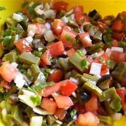 Southwestern Cactus Salad Recipe - One hour in the refrigerator allows for 'mingling' time between cilantro, jalapeno, cactus and other uniquely South-of-the-border ingredients.